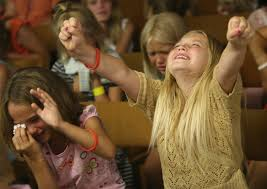 A girl receiving the fullness of the Holy Spirit